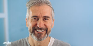Mature Male with Grey Beard Smiling Showing Teeth