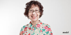Mature Female with Floral Shirt and Glasses